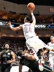 New Mexico State's Matt Taylor goes in for a shot as