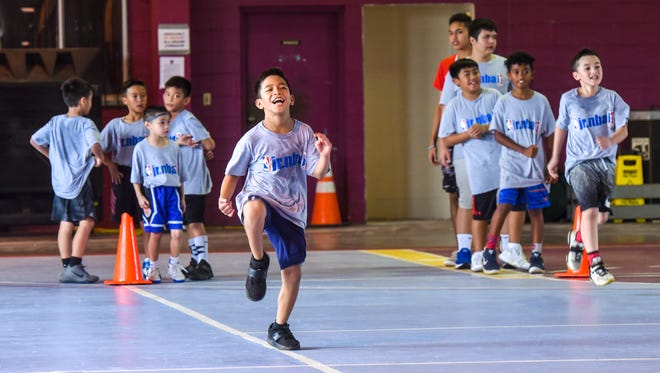 Camp participants run drills on their final day of training at the 2017 Holiday Youth Camp at the Tamuning gym in this file photo.