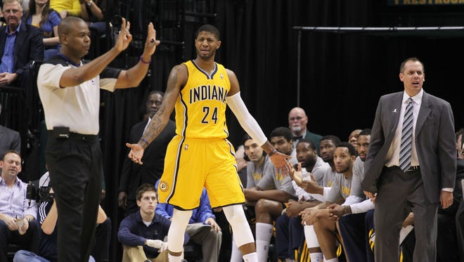 Indiana Pacers forward Paul George (24) and coach Frank Vogel are upset over an offensive foul called against George during a game against the Boston Celtics at Bankers Life Fieldhouse.