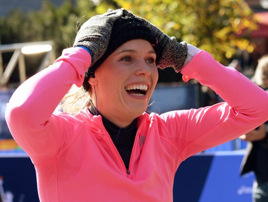 2014-11-2-caroline-wozniacki-marathon-finish