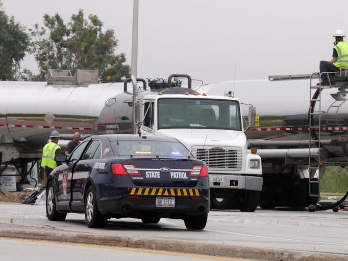 Scenes from the clean up for the semi that tipped over in the roundabout near the Interstate 43 and state Road 42 Thursday August 21, 2014 in the Town of Sheboygan.