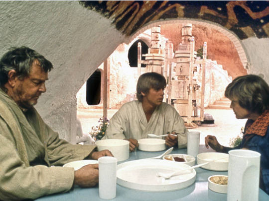 Luke Skywalker with his family in their underground dining room. This scene was filmed at the Hotel Sidi Driss in Matmata, a small town in Southern Tunisia. The hotel was the only known shooting location when when David West Reynolds and Michael J. Ryan set out.
