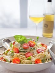 Pasta tossed with basil and tomatoes