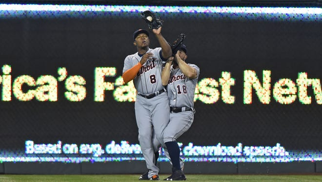 Tigers leftfielder Justin Upton (8) collides with centerfielder Tyler Collins (18) as he catches a fly ball from Royals leftfielder Alex Gordon (not pictured) to end the seventh inning of the Tigers' loss Thursday in Kansas City, Mo.