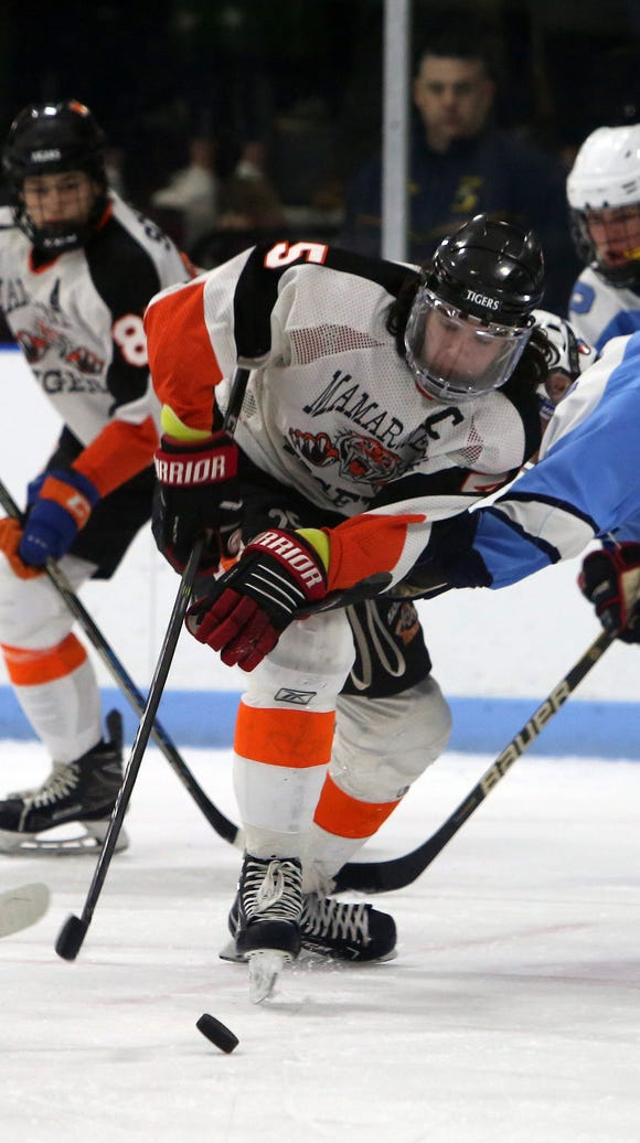 Mamaroneck's Michael Carducci (25) gets the puck around