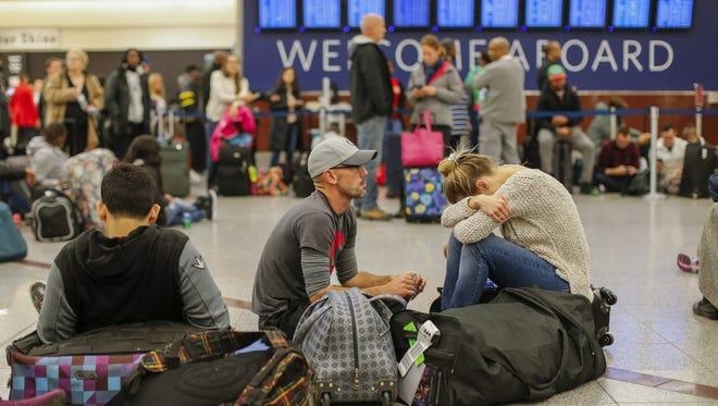 Stranded Delta Air Lines passengers wait to check in at the main terminal at Hartsfield-Jackson Atlanta International Airport  on Jan. 29, 2017.