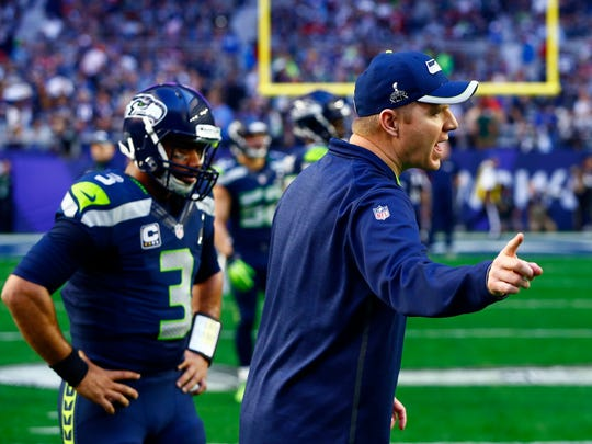 Feb 1, 2015; Glendale, AZ, USA; Seattle Seahawks offensive coordinator Darrell Bevell (right) and quarterback Russell Wilson prior to the game against the New England Patriots in Super Bowl XLIX at University of Phoenix Stadium. Mandatory Credit: Mark J. Rebilas-USA TODAY Sports
