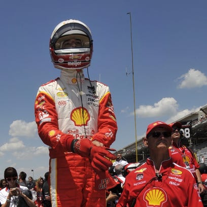 Helio Castroneves waits for his next heat in the Pit