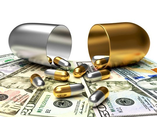 pills-on-money-gettyimages-507799948_large.jpg