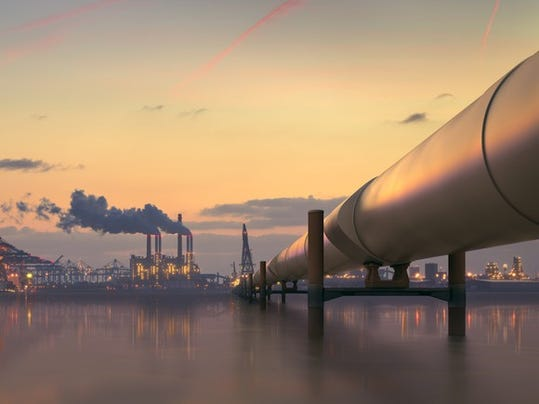 oil-pipeline-in-industrial-district-with-factories-at-dusk_large.jpg