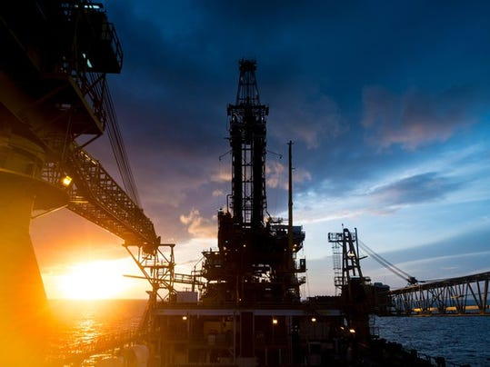 an-offshore-oil-platform-with-the-sun-rising-in-the-background_large.jpg