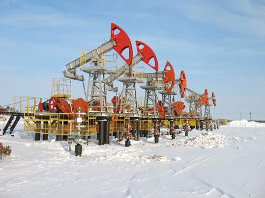 a-row-of-oil-pumps-in-the-snow_large.jpg