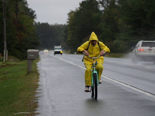 Steven Macowsky, of Oak Orchard, rides back home on Harbeson Road from his job in Milton on Friday, Oct. 2, 2015. Heavy rain and strong wind was brought to bear on coastal Sussex Friday.
