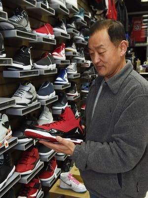 Hyundo Chong, 53, owner of City Footwear in the City of Poughkeepsie.