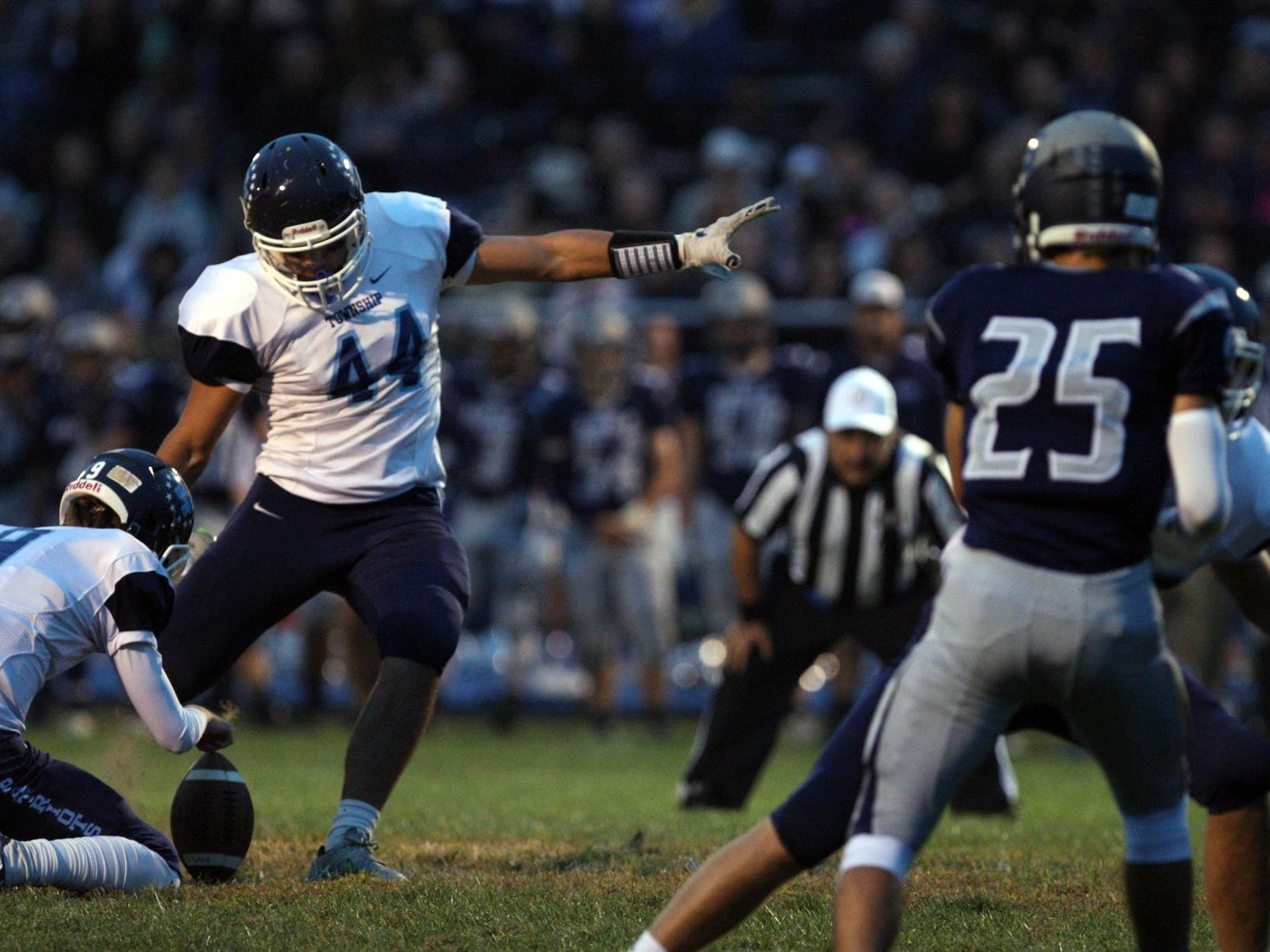 Nick Galenti, #44 Freehold Township, kicks a successful extra point with holder Kevin Doherty, #9, as they play Howell in a football game Friday, September 25, 2015, at Howell High School.