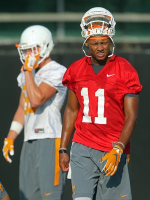 Tennessee quarterback Joshua Dobbs takes a break during the first day of practice Monday, Aug. 1, 2016.