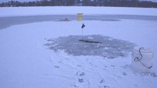 Anglers are ice fishing on the Upper Chippewa Basin in November 2014.