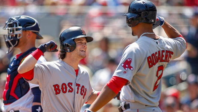 Boston Red Sox center fielder Andrew Benintendi (16) celebrates with shortstop Xander Bogaerts (2) after his two-run home run against the Minnesota Twins in the first inning at Target Field on May 7.