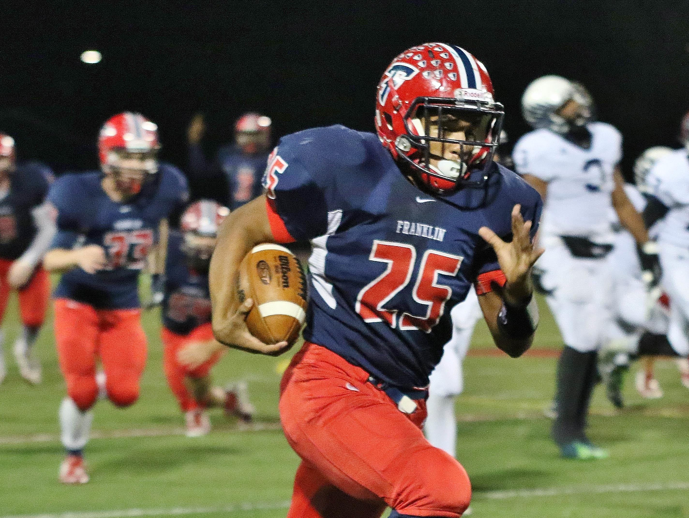 Franklin's Jacob Clark had a huge night running the ball during the Patriots' 33-30 victory over Farmington.