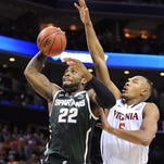 MSU's Branden Dawson blocks a shot by Virginia's  Justin Anderson during their NCAA tournament game Sunday in Charlotte. Dawson finished with four blocked shots.