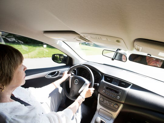 Frances Donovan, a Fort Myers resident takes a driving course with instructor Jay Anderson, right.