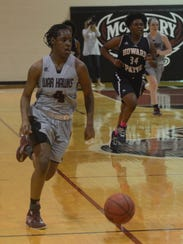 McMurry's Sham Hunter leads a fast break during the