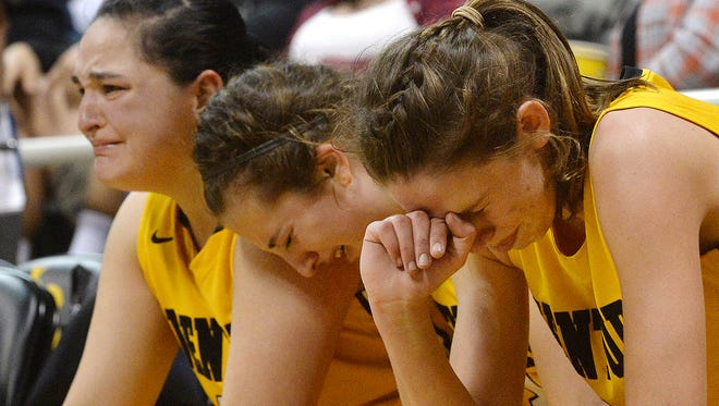 Ventura's Svannah Page, from left, Kayla Togneri and Aubrey Knight take in the final moments before Windward claims victory in the CIF State Southern California Division I championship by a score of 61-43. The game was played Saturday at the Long Beach State Pyramid.