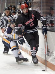 Penfield's Andrew Ebersol, right, skates past Victor's Kai Miller.