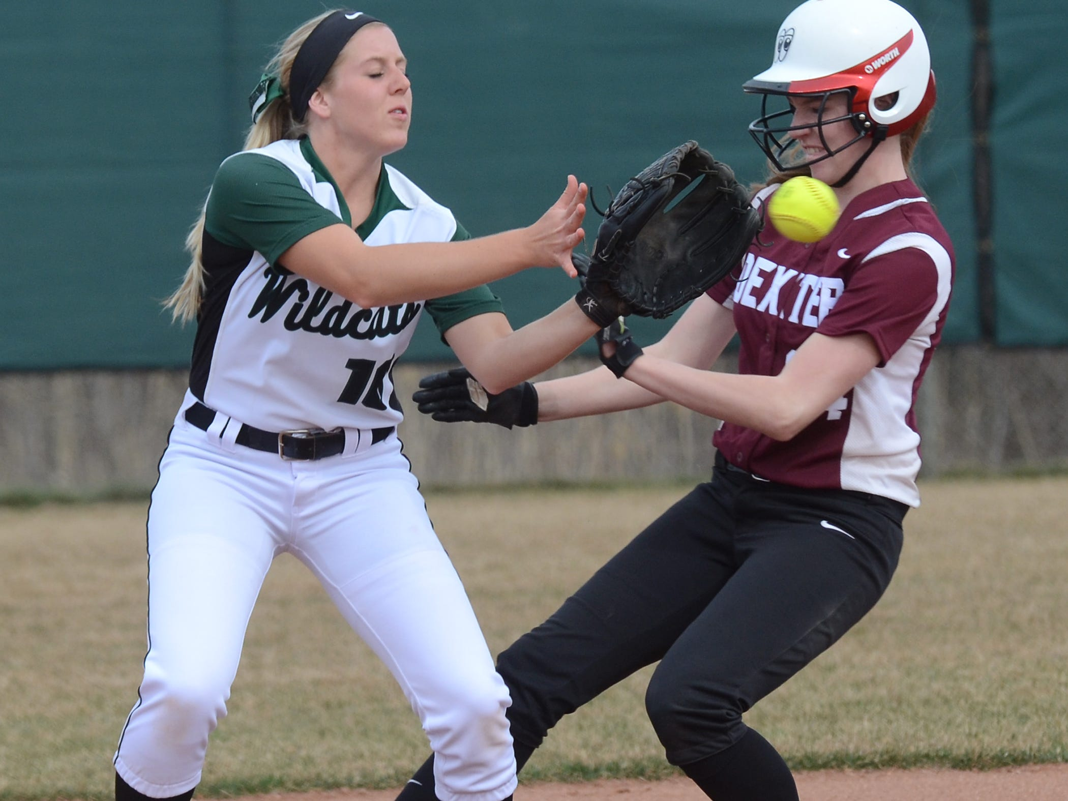 Novi's Jenna Lowney (left) takes the throw in time to get the force-out in a victory over Dexter.