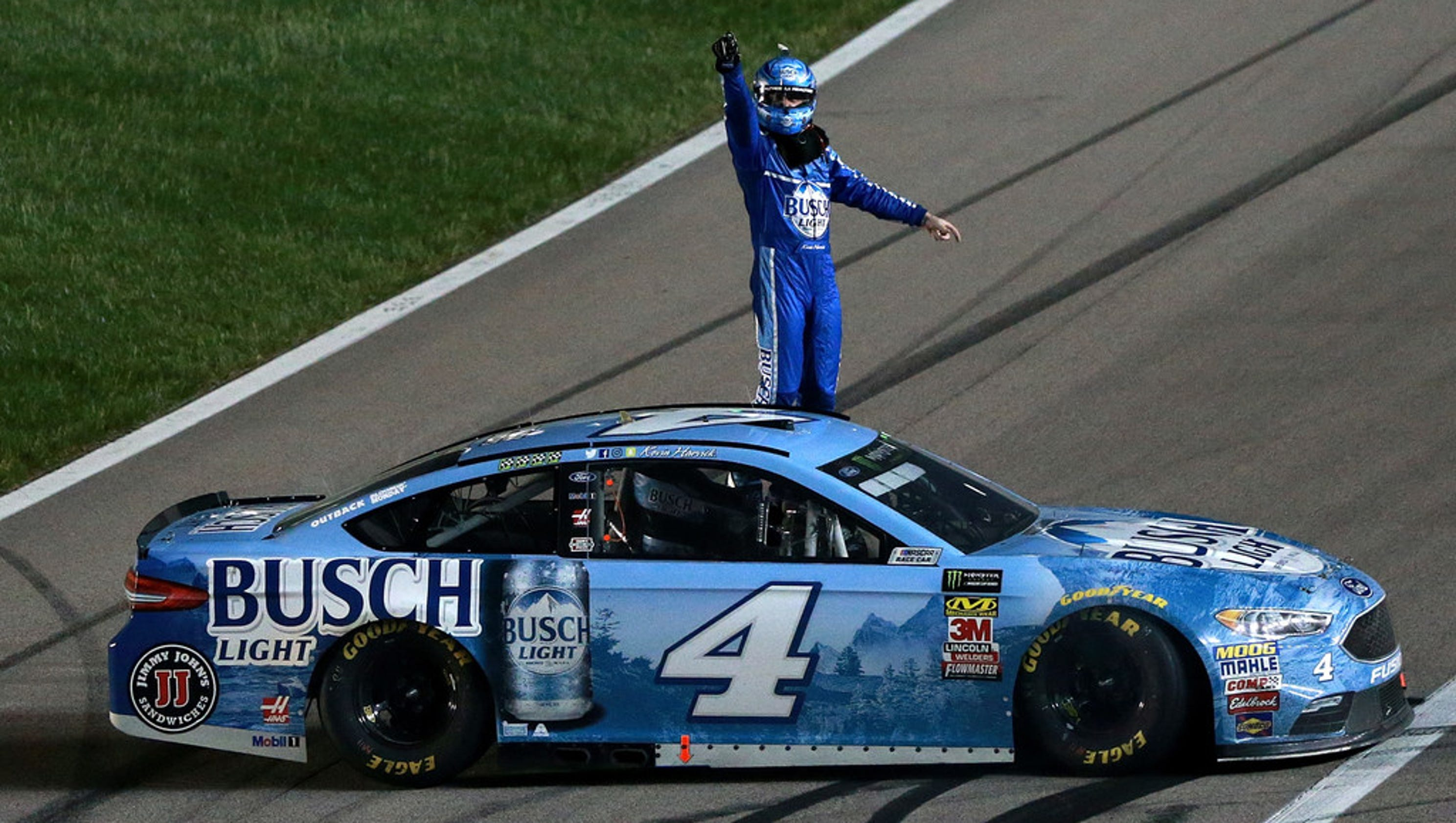 636618082347157653-harvick-on-winning-car