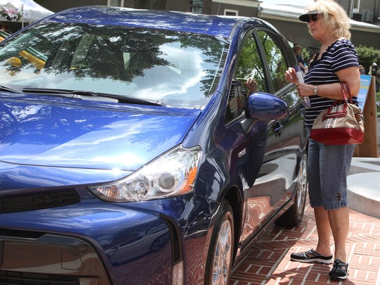 Barbara Levis checks out the Toyota Prius on display at the Festival Earth, a sustainability fair at the Vail Mansion in Morristown on May 17, 2015.