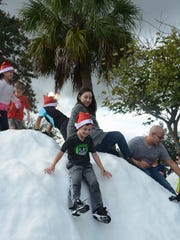 Anthony Perez-Leon, 6, of Golden Gate, takes a snowy plunge during last year's Snowfest in Golden Gate.