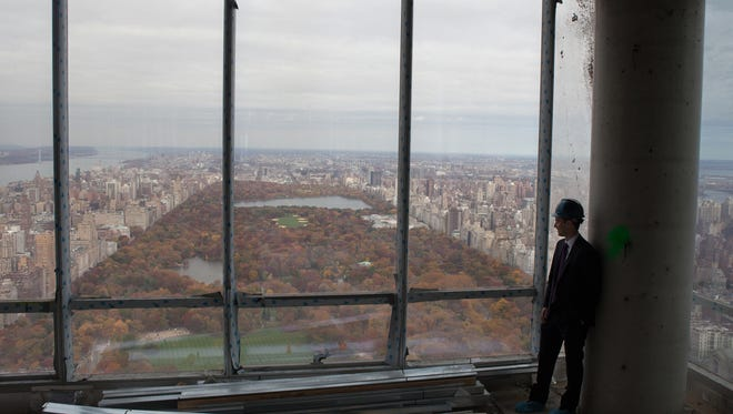 Jeff Dvorett, vice president development at Extell Development, looks at the view from the 87th floor of One57, the 1,004' tall apartment tower across from Carnegie Hall on 57th Street on Nov. 6, 2013. A new breed of supertall, superslim luxury apartment tower reshapes the New York skyline.