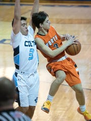 Middletown North's Rob Higgins (3, orange) gets tangled up as he tries to dish the ball. Defending is CBA's John Salcedo (3, white). CBA hosted Middletown North in boys basketball at their high school in Lincroft, NJ, on Thursday, February 18, 2016. /Russ DeSantis for the Asbury Park Press / Slug:ASB 0219 SCT Boys Hoops Roundup