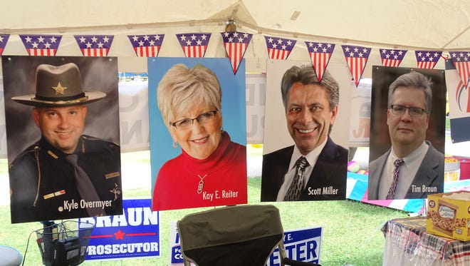 Sandusky County Republican tent featuring posters of candidates for the November election. Sandusky County Sheriff Kyle Overmyer remains on the ballot despite facing 43 criminal charges including allegation of theft of pain medication, falsifying financial statements and theft of office. Volunteers in the tent said Overmyer is still the sheriff until told otherwise and that the sheriff is innocent until proven guilty.