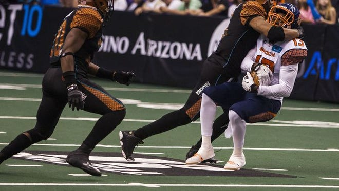Rattlers jack linebacker Kerry Reed makes a big hit against the Spokane Shock.