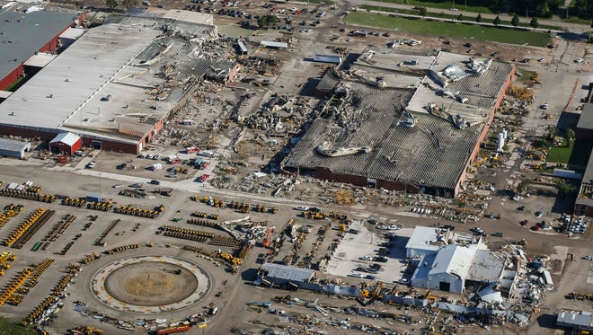 Aerial view of extensive tornado damage to production plants Thursday, July 19, 2018, at Vermeer Corp., a farm and construction equipment manufacturer in Pella, Iowa. Emergency workers were treating injured workers and visitors.