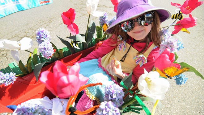 Katie Murto Troy decorated a wagon with flowers for the 2014 edition of the MI  Earth Day Fest in downtown Rochester.