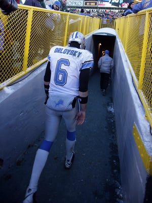 Lions QB Dan Orlovsky leaves the field after their 31-21 loss to the  Packers to end their season winless at 0-16 on Dec. 28, 2008.