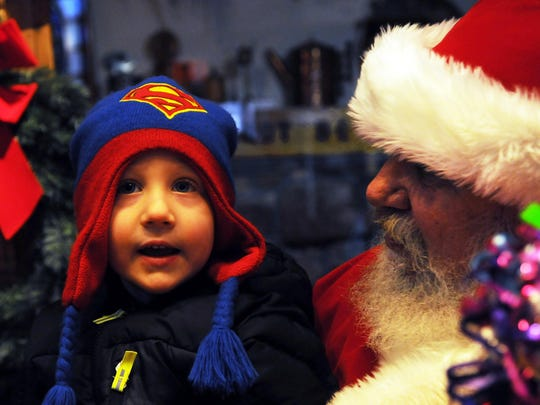 """Leathem Vogel of Sturgeon Bay gives his memorized wish list to Santa at the Door County Historical Museum during last year's """"Christmas By the Bay"""" in Sturgeon Bay."""