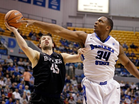 Indiana State forward Brandon Murphy (34) fouls Butler forward Andrew Chrabascz (45) as he shoots in the first half of an NCAA college basketball game in Terre Haute, Ind., Wednesday, Dec. 7, 2016. (AP Photo/Michael Conroy)