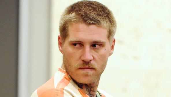 Scott Thomas White, 28, of Santa Cruz, leaves his arraignment