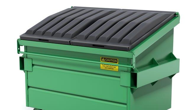 Green trash dumpster.