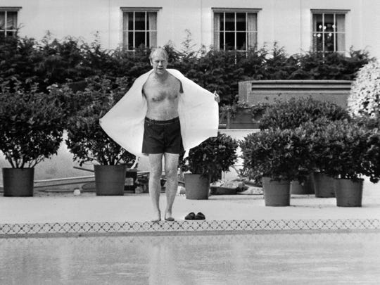 President Gerald Ford prepares to take a swim at the new swimming pool of the White House in July 1975.