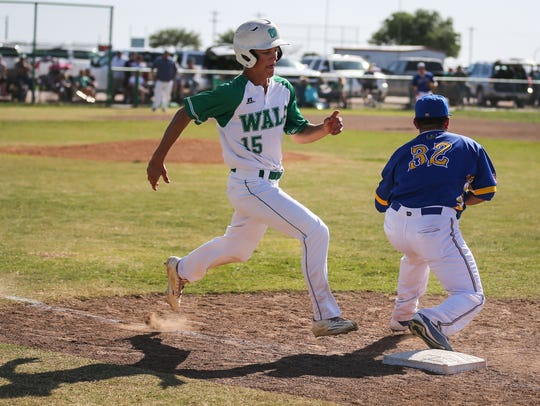 Reagan County's Angel Gallegos tags out Wall's Caleb