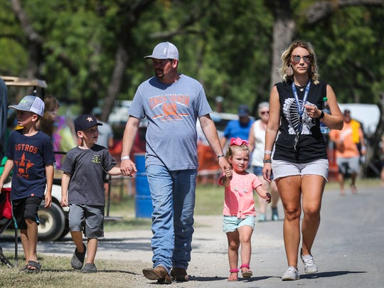 Spectators walk around the spectator area during Showdown in San Angelo Saturday, June 23, 2018 at Spring Creek Park.