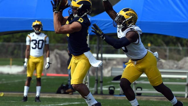 "U-M's Grant Perry, left, and Jabrill Peppers practice in Florida in February. ""I feel like I've made some huge strides, as the Citrus Bowl showed,"" Perry said of his improvements."