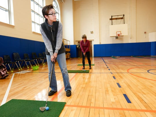 Robin Mincow from New City works on her chipping during a golf class at the Clarkstown Learning Center in Congers on Friday, March 31, 2017.