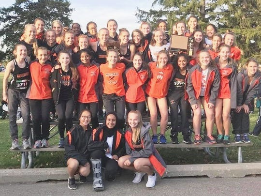 The Northville girls cross country team won its eighth straight KLAA title.