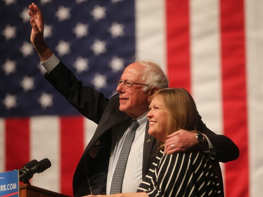 Democratic presidential candidate Sen. Bernie Sanders, I-Vt., waves to the crowd with his wife, Jane Sanders, by his side during a campaign rally Tuesday, April 5, 2016, at the University of Wyoming in Laramie, Wyo. Sanders won the Democratic presidential primary in Wisconsin on Tuesday.